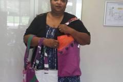 Sawsan-from-Womens-Creative-Hub-displaying-Banner-Bags