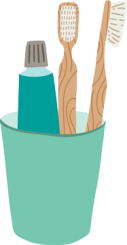 Toothpaste and bamboo toothbrushes in a cup.
