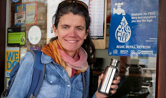 Rebecca Prince-Ruiz, the founder of Plastic Free July, is holding a reusable water bottle