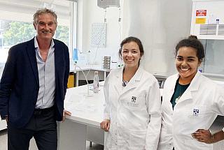 Three staff members in a lab