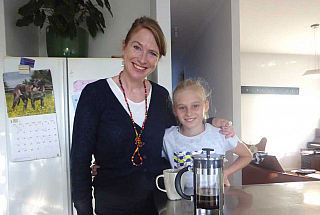 Sharon and her daughter in their kitchen with a plunger coffee